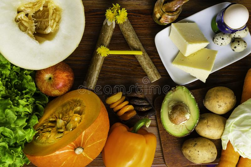 Vitamin A in food, Natural products rich in vitamin A as pepper, carrot, pumpkin, apple, potato, cabbage, avocado,dried apricots,. Melon, anchovy, yellow cheese stock photos