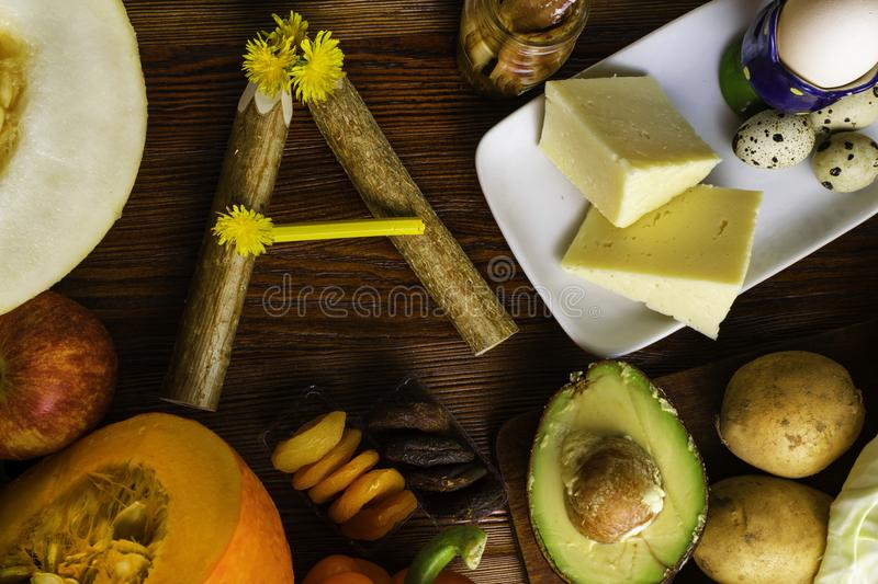 Vitamin A in food, Natural products rich in vitamin A as pepper, pumpkin, apple, potato, cabbage, avocado,dried apricots, melon, a. Nchovy, yellow cheese, egg royalty free stock photography