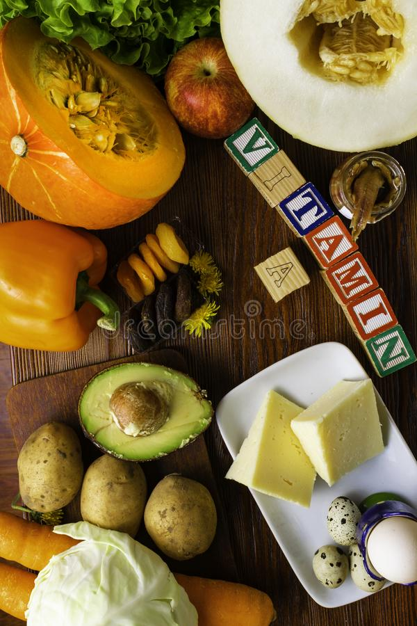 Vitamin A in food, Natural products rich in vitamin A as pepper, pumpkin, apple, potato, cabbage, avocado,dried apricots, melon, a. Nchovy, yellow cheese, egg stock photo