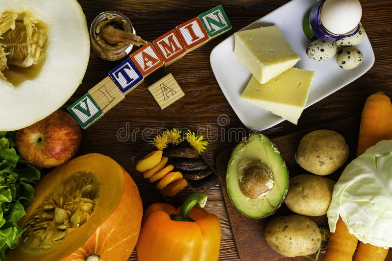 Vitamin A in food, Natural products rich in vitamin A as pepper, pumpkin, apple, potato, cabbage, avocado,dried apricots, melon, a. Nchovy, yellow cheese, egg royalty free stock photo