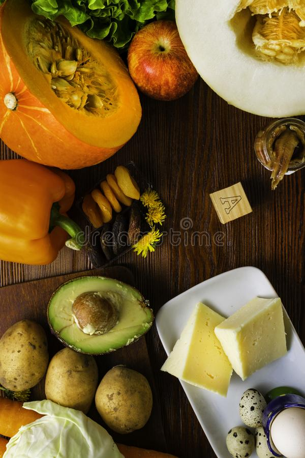 Vitamin A in food, Natural products rich in vitamin A as pepper, pumpkin, apple, potato, cabbage, avocado,dried apricots, melon, a. Nchovy, yellow cheese, egg royalty free stock images