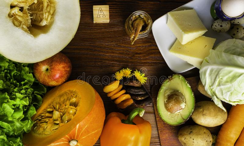 Vitamin A in food, Natural products rich in vitamin A as pepper, pumpkin, apple, potato, cabbage, avocado,dried apricots, melon, a. Nchovy, yellow cheese, egg royalty free stock photos