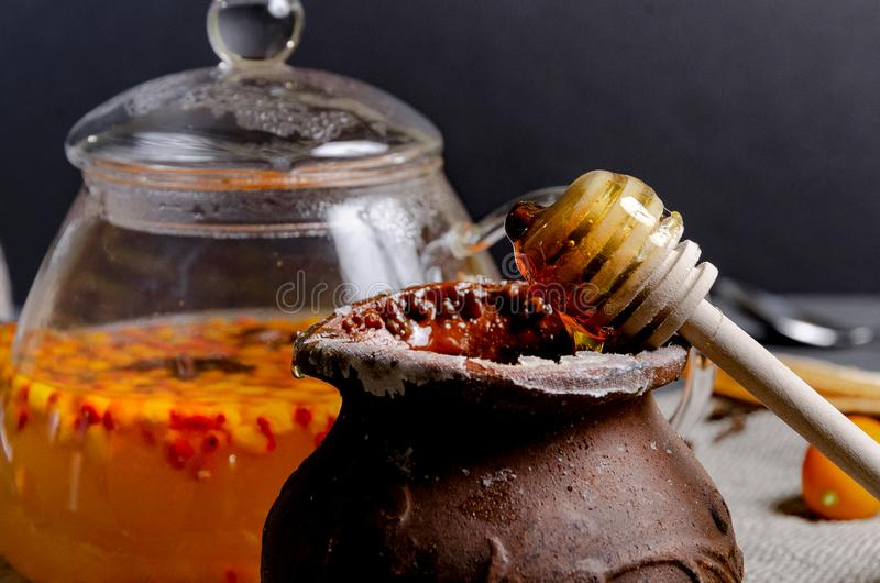 Vitamin healthy sea buckthorn tea in glass cups with fresh raw sea buckthorn berries stock images