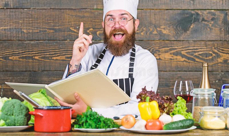 Vitamin. man use kitchenware. Dieting with organic food. Fresh vegetables. Happy bearded man cooking in kitchen. Professional chef in cook uniform. Healthy royalty free stock image