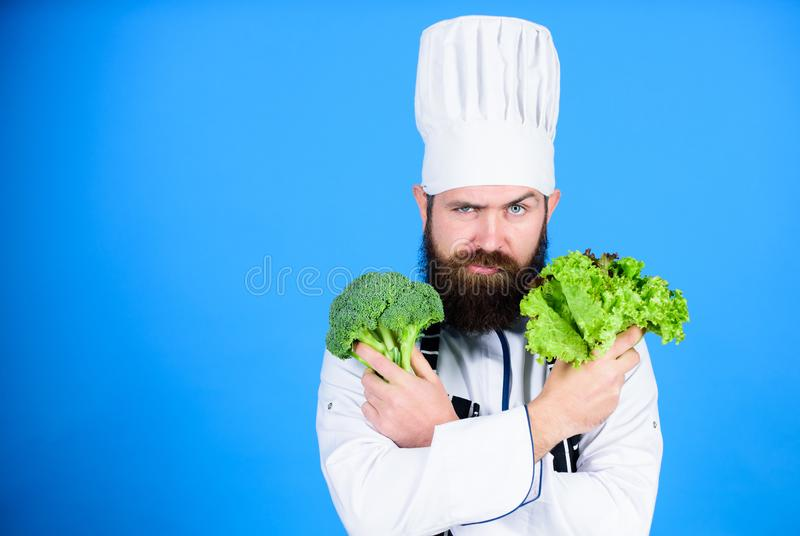 Vitamin. man use kitchenware. Professional chef in uniform. Healthy food and vegetarian. serious man cooking in kitchen. Dieting with organic food. Fresh stock photography