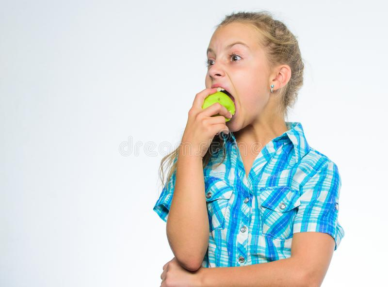Vitamin nutrition concept. Good nutrition is essential to good health. Find out which vitamins and minerals your body. Need. Kid girl eat green apple fruit royalty free stock image