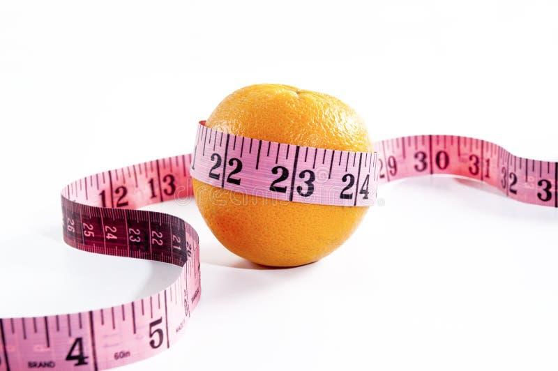 Vitamin Orange. Orange measuring tape on white background stock photos