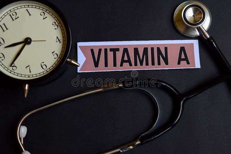 Vitamin A on the paper with Healthcare Concept Inspiration. alarm clock, Black stethoscope. royalty free stock images