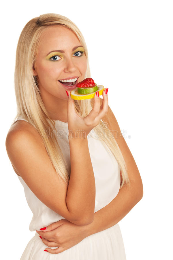 Vitamin sandwich. Girl with vitamin sandwich made of lemon, lime and strawberry stock photos