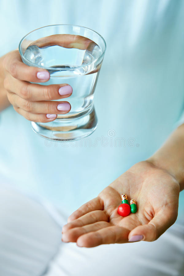 Vitamin And Supplement. Close Up Of Woman Hand Holding Pills stock photos