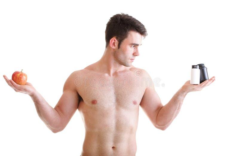 A vitamina ou a tabuleta do arrasto dos comprimidos encaixotam o homem dos suplementos isolado fotos de stock royalty free
