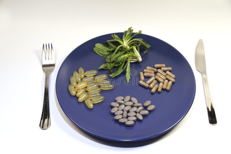 Vitaminas y suplementos fotos de archivo libres de regalías