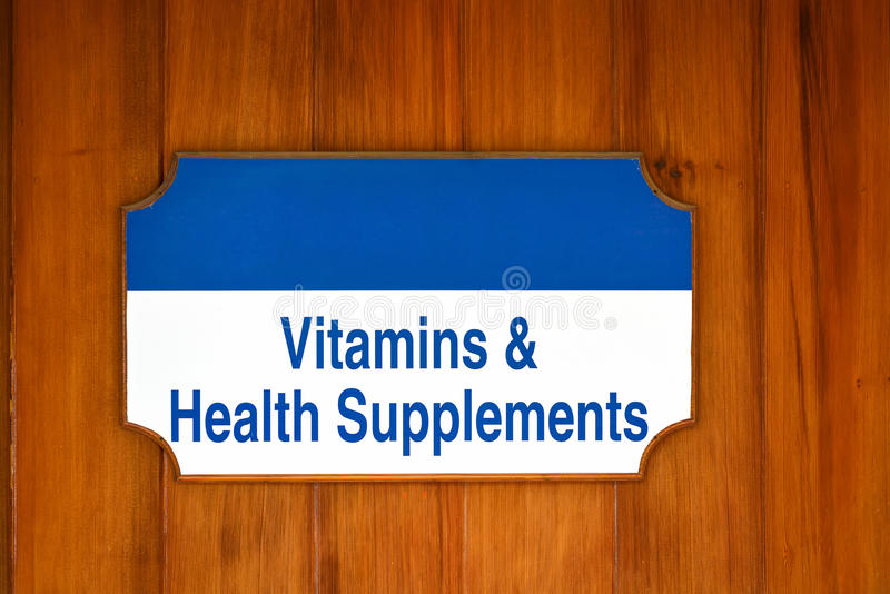 Vitaminer hälsa kompletterar tecknet royaltyfri foto