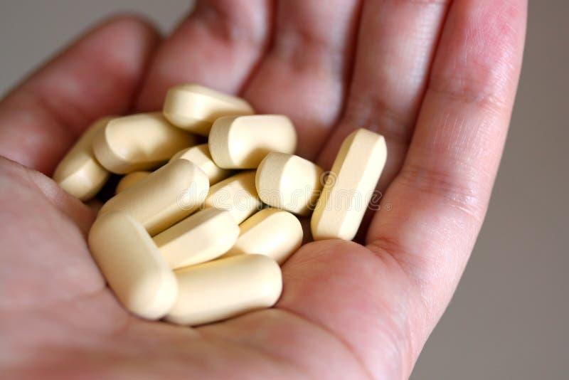 Vitaminetabletten stock afbeeldingen