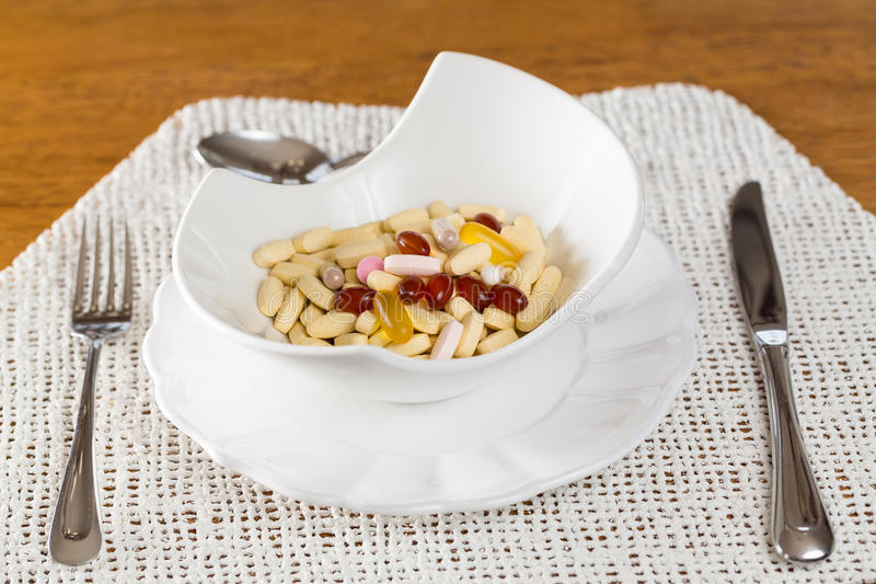 Download Vitamins In Bowl Of Tablets Stock Photo - Image: 25995274