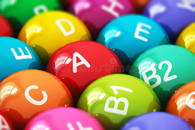 Vitamins. Creative abstract health lifestyle, diet and healthy eating and nutrition food concept: macro view of color balls, pills or tablets with vitamins names royalty free illustration