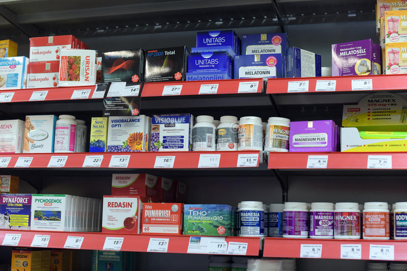 Vitamins on supermarket shelves royalty free stock photography