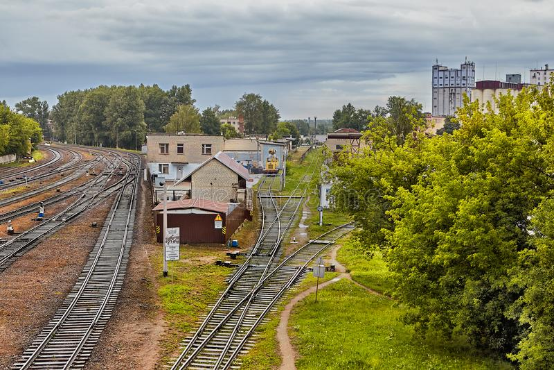 Railway and granaries among trees, Vitebsk, Belarus. royalty free stock images