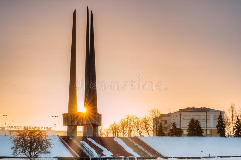 Vitebsk, Belarus. Sun Shines Through Main Monument Three Bayonets. Of Memorial Of Liberators Near Victory Park. Monument To Heroes Who Died In Battles For royalty free stock photo