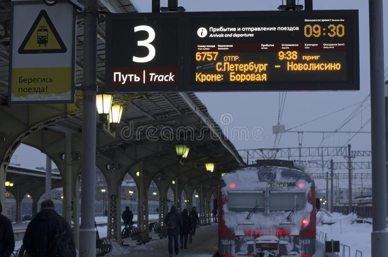 Luminous scoreboard with the schedule of trains. Vitebsky railway station,Saint Petersburg,Russia - January 24, 2019: Luminous scoreboard with the schedule of stock photos