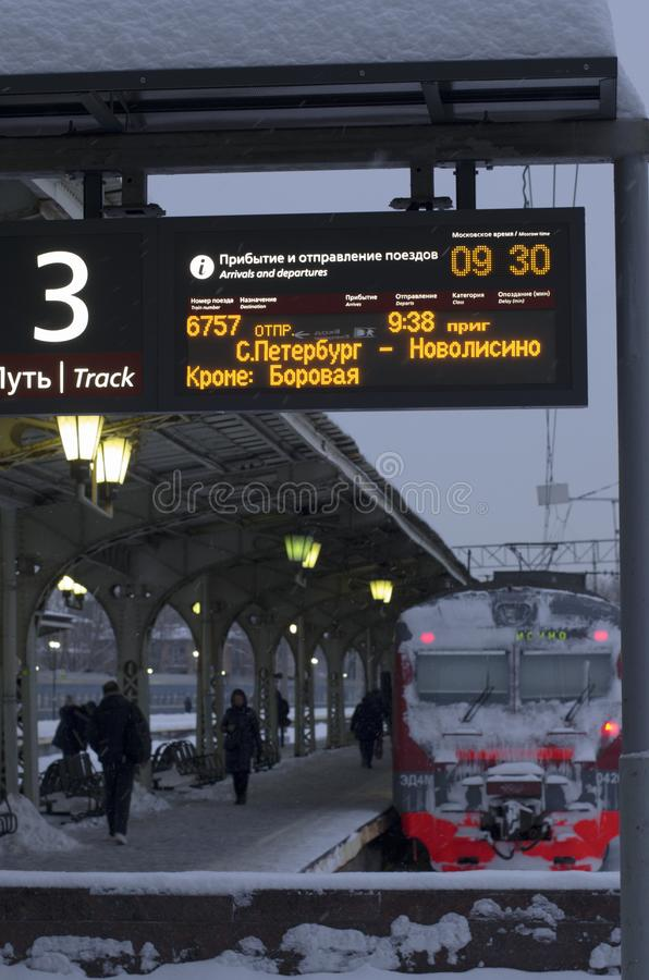 Luminous scoreboard with the schedule of trains. Vitebsky railway station,Saint Petersburg,Russia - January 24, 2019: Luminous scoreboard with the schedule of stock image