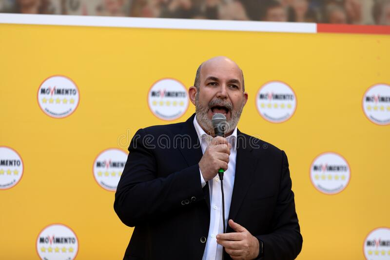 Vito Crimi on stage speaks to the crowd in the square stock photography