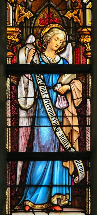 Vitral - ángel con el monedero fotografía de archivo libre de regalías