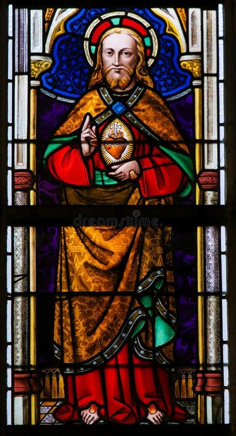 Vitral - Jesus Christ e o coração sagrado imagem de stock