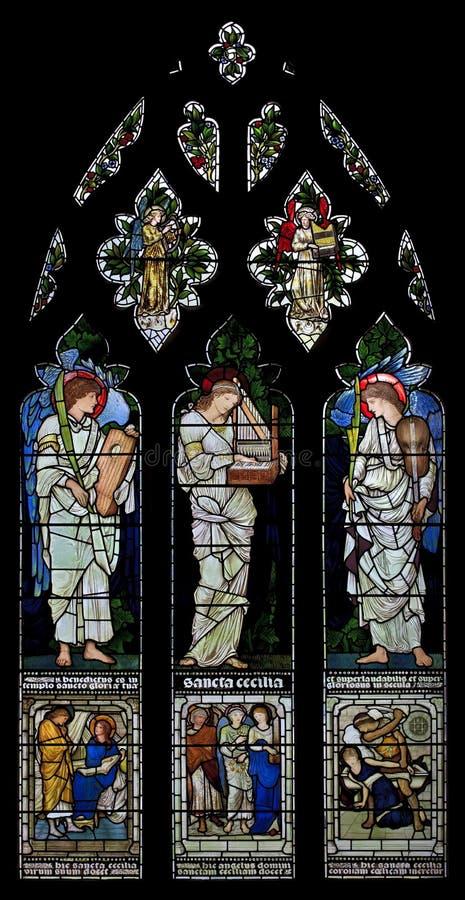 Vitral St Cecilia de St Cecilia (lugares sagrados Cecilia) en la iglesia de Oxford Cristo, Inglaterra, Reino Unido imagen de archivo libre de regalías