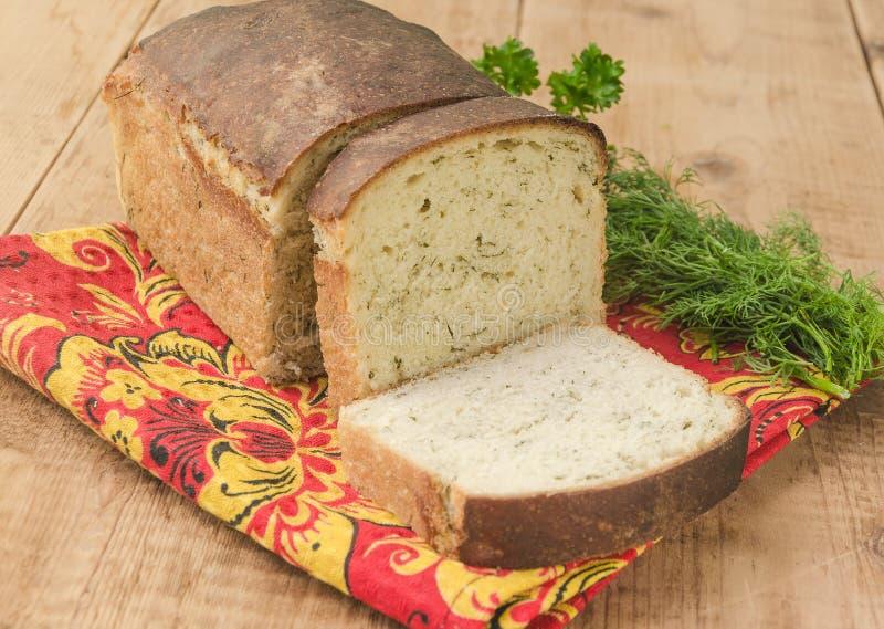 Vitt bröd släntrar med dill arkivfoto
