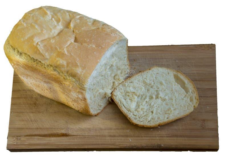 Vitt hemlagat bröd på trät som isoleras på vit arkivfoto