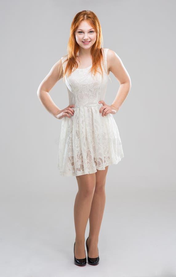 vitt kvinnabarn för klänning arkivfoto
