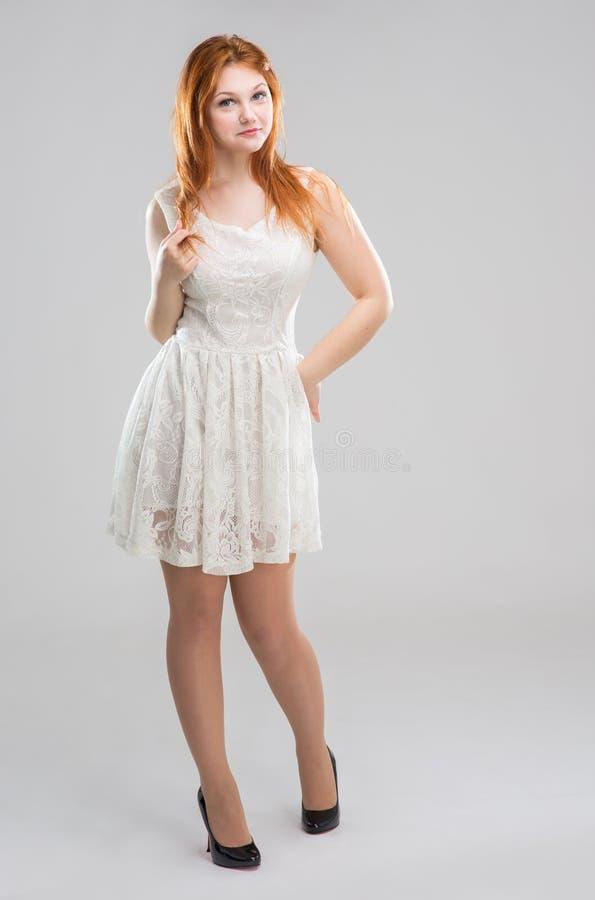 vitt kvinnabarn för klänning arkivfoton