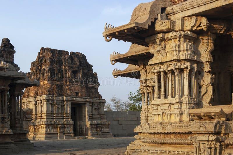 Vittala Temple Gopuram and musical pillars at Hampi, Karnataka, India.  stock photo