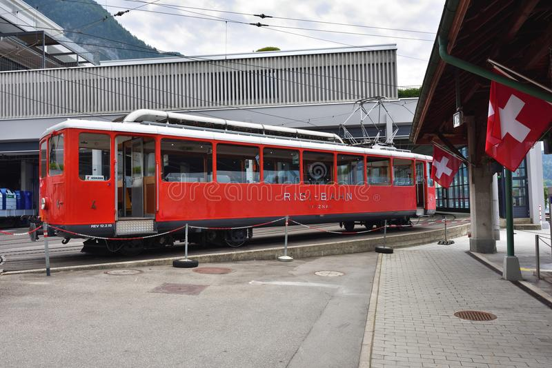 Red Train at Vitznau station, Lucerne Switzerland royalty free stock images