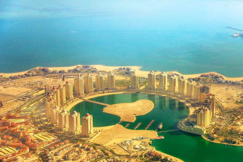 Viva Bahriya scenic flight. Details of towers of the Pearl-Qatar, the artificial island in Persian Gulf, Doha, Qatar, Middle East. Scenic flight of Viva Bahriya stock image