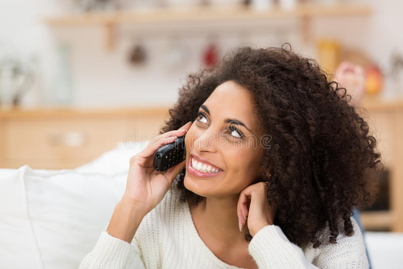Vivacious African American lady on her mobile royalty free stock photo