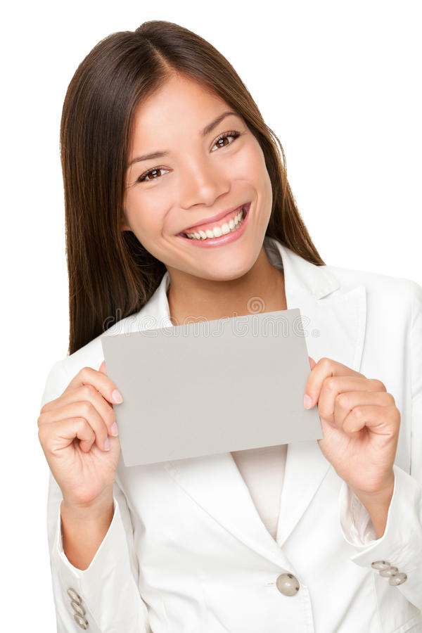 Vivacious Asian woman with grey card royalty free stock images