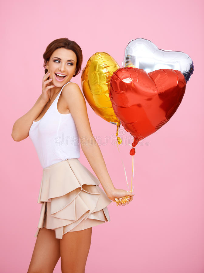 Vivacious Woman With Heart Shaped Balloons Stock Photography