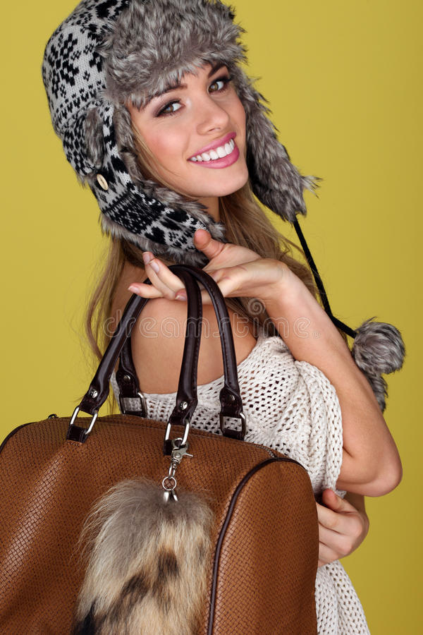 Vivacious Young Woman Carrying Bag Stock Photo
