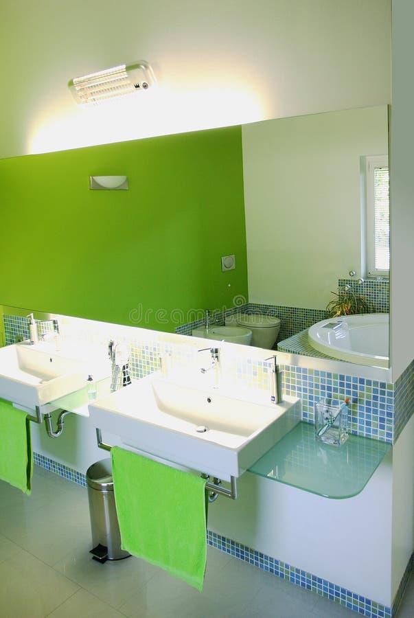Vivid bathroom in a green mosaic stock photos