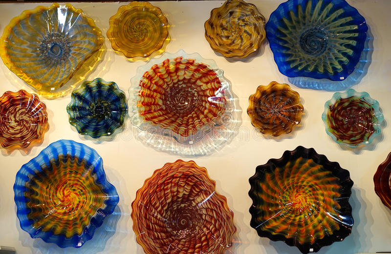 Vivid blown glass bowls. These hand blown bowls are individually hand crafted in a forge and cooled in a kiln. The molten glass is worked carefully and with stock photography