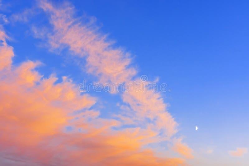 Vivid blue and scarlet clouds at White Nights. Vivid blue and scarlet clouds in the sky during White Nights season stock photos