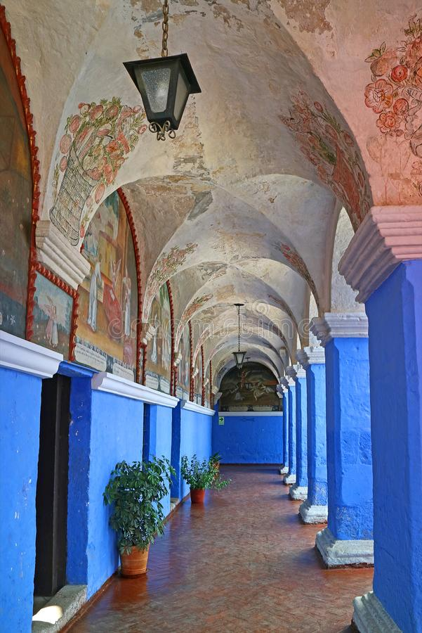 Vivid Blue Wall and Columns in Monastery of Santa Catalina Decorated with Religious Fresco Paintings, Arequipa, Peru stock photos