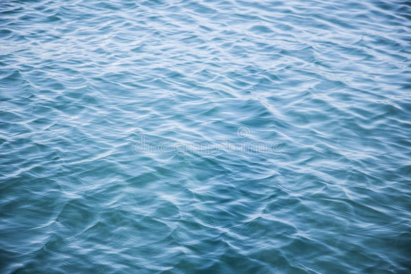 Vivid blue wavy mediterranean ocean water stock photography