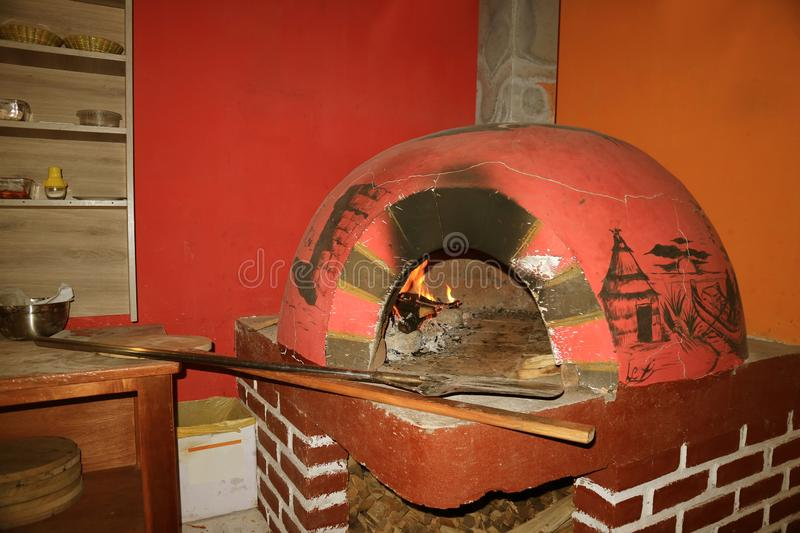 Vivid Colored and Unique Painted Wood Fired Brick Pizza Oven, Peru, South Americ royalty free stock image