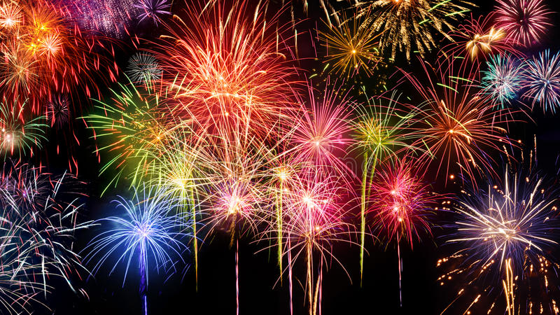Vivid fireworks display on black royalty free stock image