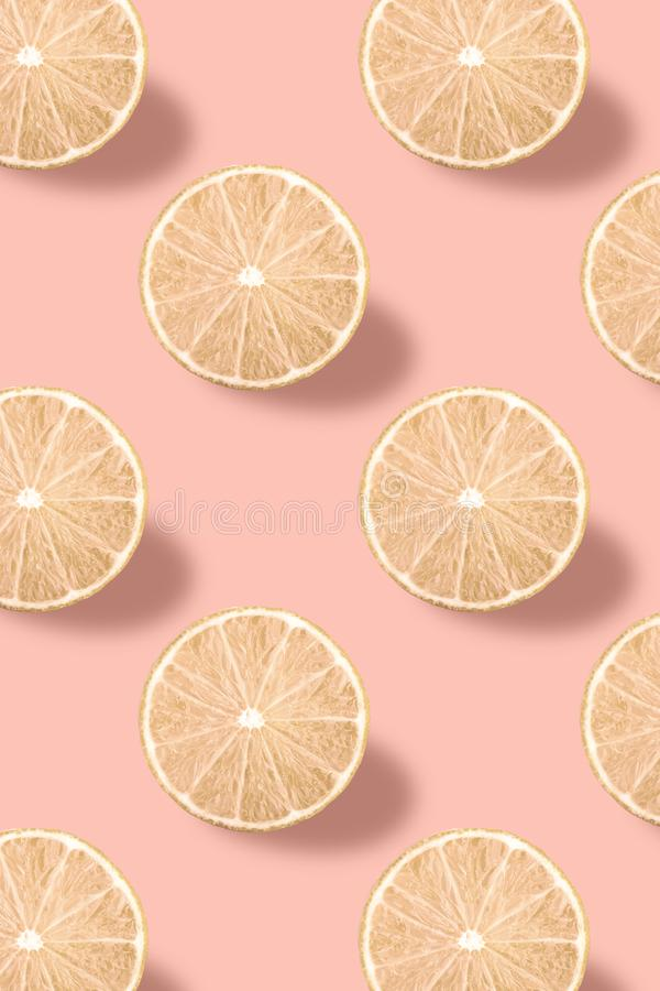Vivid fruit pattern of fresh lime on colourful background. Colorful fresh slices lime texture on light pink background. From top view. full depth of field stock photo