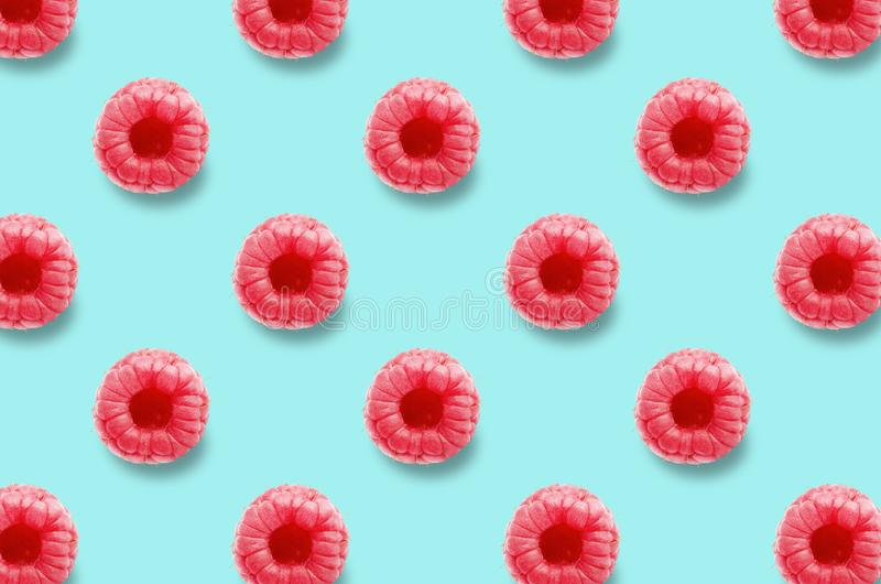 Vivid fruit pattern of fresh raspberries on colourful background. Raspberry texture on light blue pastel background. Full depth of field. Patterns for blog or royalty free stock photos
