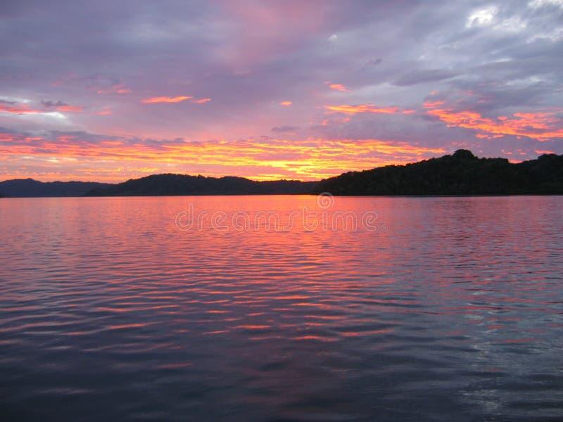 Vivid ocean sunset stock photo